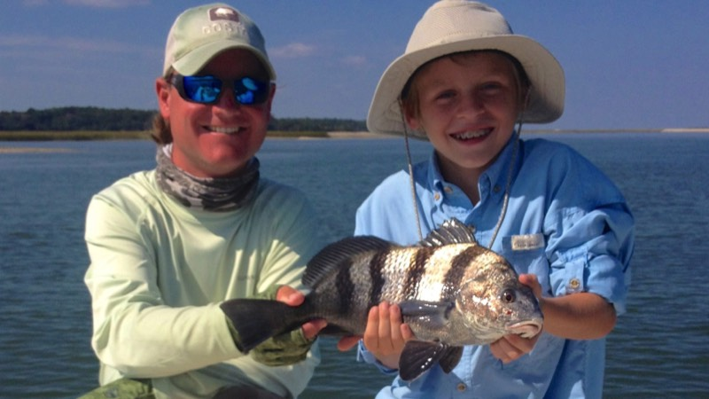 captain blair and young fisherman holding a fish caught on Hilton Head charter trip